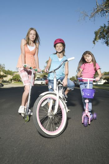 Children with scooters and bicycle