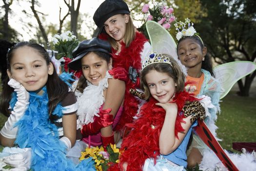 Girls (7-12) wearing colorful costumes