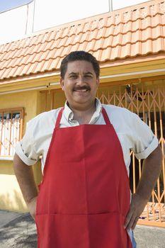 Portrait of restaurant owner outdoors