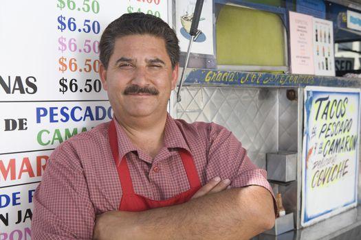 Portrait of man outside cafe