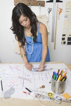 Female fashion designer working at desk