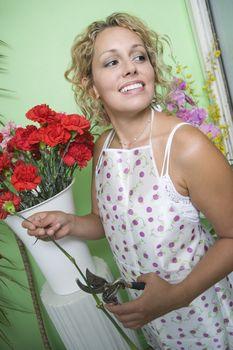 Female florist trimming flowers