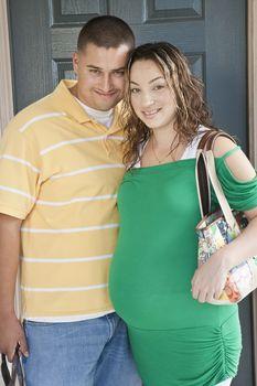 Portrait of expectant couple