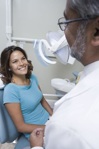 Female Patient At Dental Clinic For Checkup