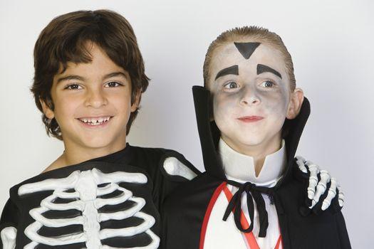 Portrait of boys (7-9) wearing Halloween costumes