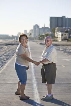 Senior couple on promenade holding hands