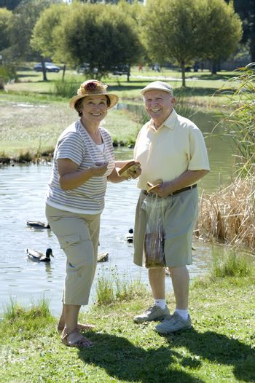 Senior couple standing on lawn portrait