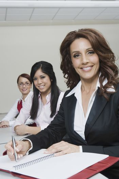 Cheerful Multi Racial Businesswomen Sitting at Desk