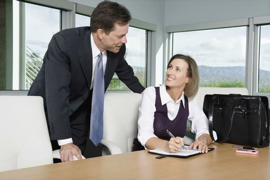 Business People Chatting in Meeting Room