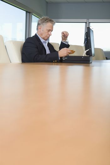 Serious Businessman with Open Briefcase