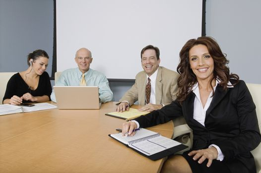 Group of Cheerful Business People at a Meeting