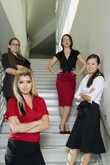 Group of Serious Businesswoman on Stairs Low Angle