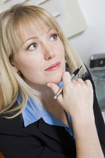 Pensive Financial Advisor looking away while in deep thought