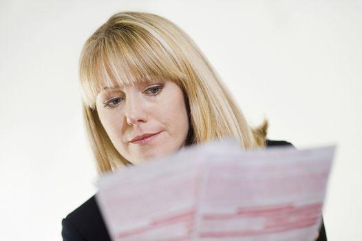 Serious financial advisor studying paperwork