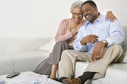 Cheerful Senior Couple On Couch
