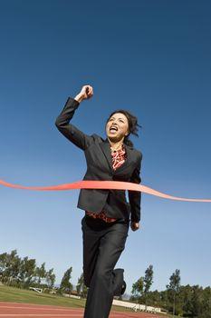 Businesswoman Crossing the Winning Line