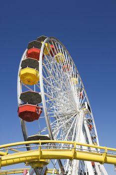 Ferris Wheel Against A Blue Sky