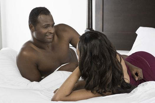 Mid adult couple lying on bed