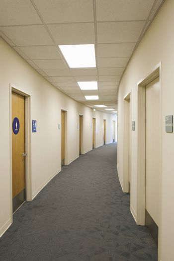 View of an empty corridor with closed doors