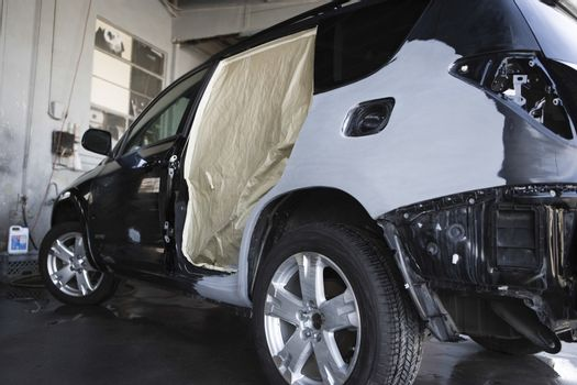 View of a damaged sports utility vehicle in garage