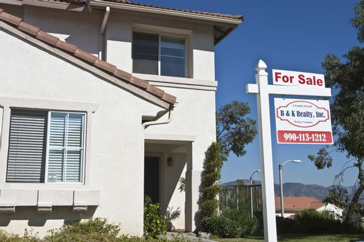 Residential structure with 'For Sale' sign