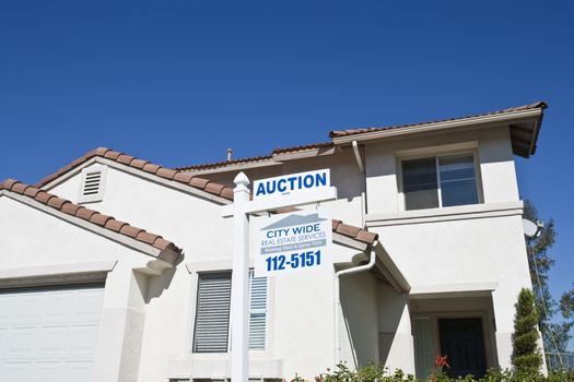 Auction sign in front of a residential structure