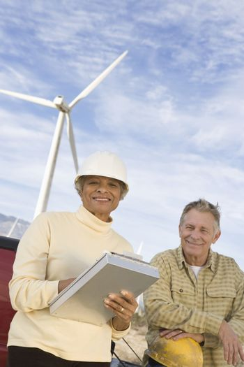 Couple working at wind farm