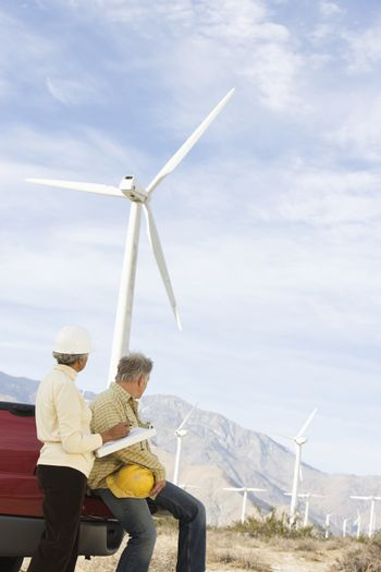 Couple looking at wind farm