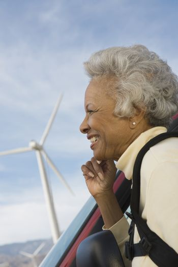Mature woman by wind farm