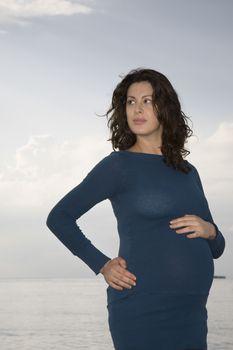Pregnant woman at ocean