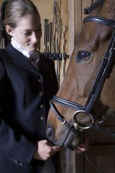 Female horseback rider with horse