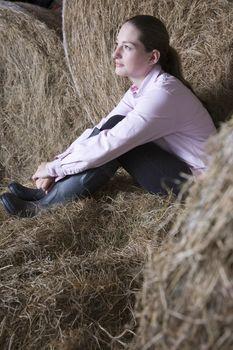 Girl relaxing in barn