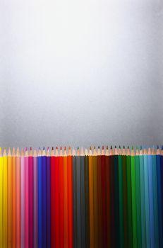 Row of multi colored pencils