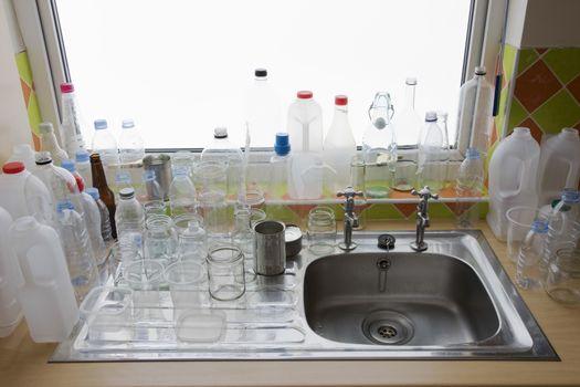 Clean bottles at kitchen sink