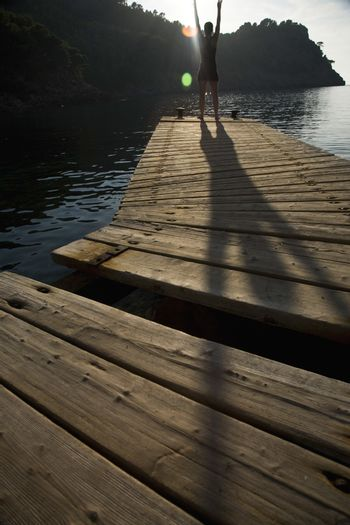 Person exercising on jetty