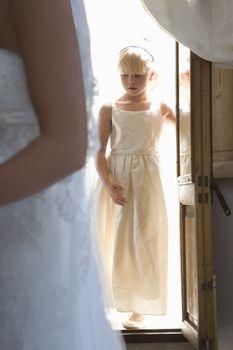 Girl entering house during wedding reception