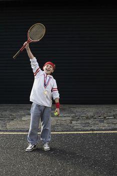 Boy winning tennis match