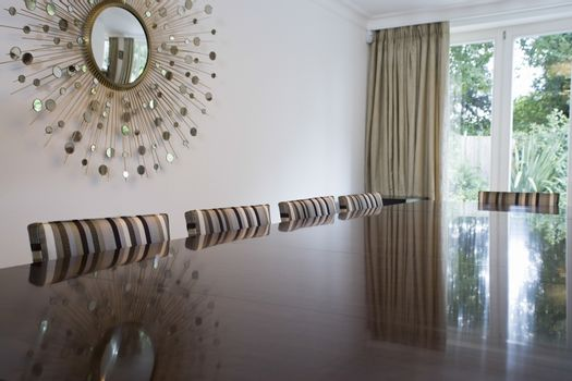 Reflection on table top in dining room
