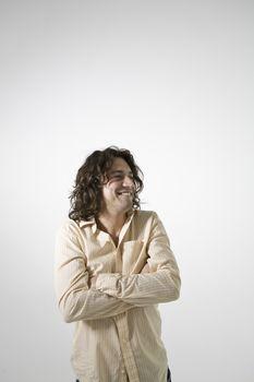 Mid-adult man smiling studio shot