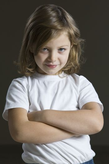 Studio portrait of girl with arms crossed