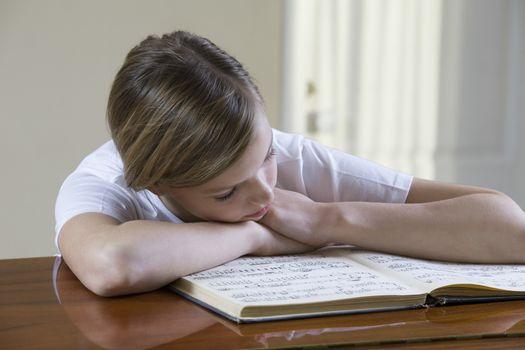 Girl (13-15) studying