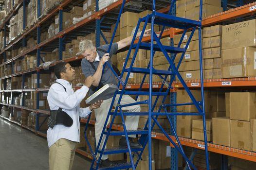 Men working in distribution warehouse