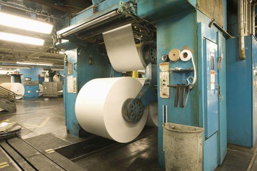 View of huge rolls of paper in newspaper factory