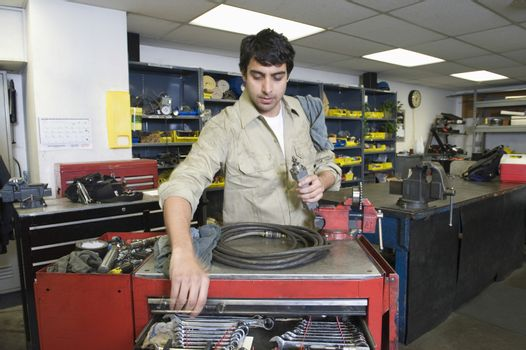 Young man working in workshop