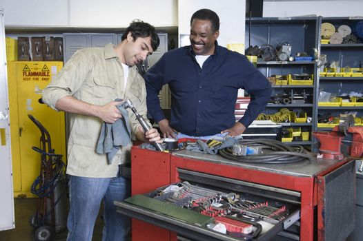 Two men in workshop with tools