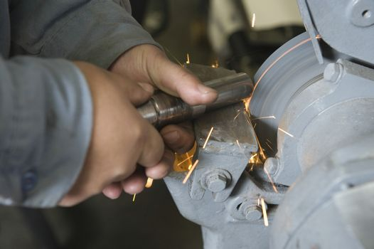 Closeup of sparks while grinding metal in workshop