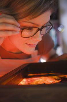 Artist examining textiles close-up