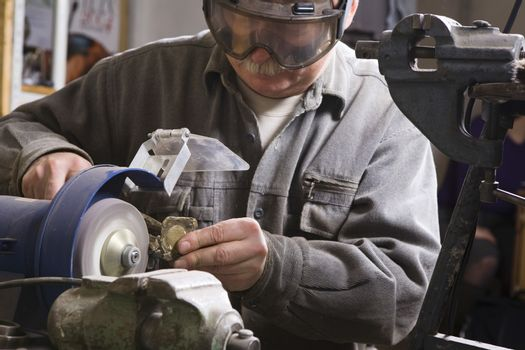 Craftsman working with stone close-up