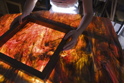 Artist producing textiles close-up