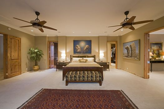 Bedroom interior with ceiling fans